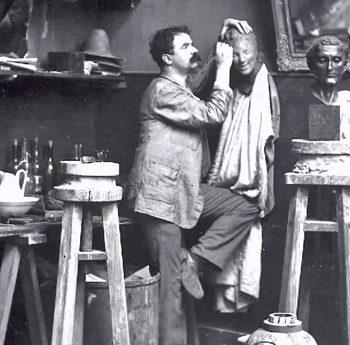 Medardo Rosso sculptor in his studio