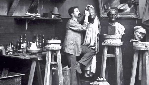 Medardo Rosso sculptor in his studio